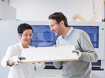 Employees with wooden board